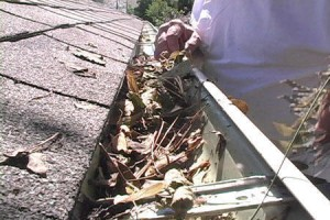 man starting gutter cleaning